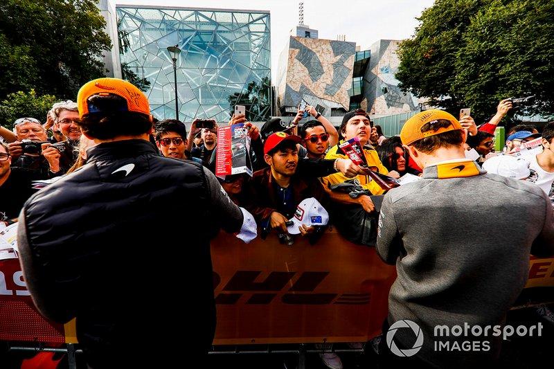 Carlos Sainz Jr., McLaren and Lando Norris, McLaren sign autographs for fans at the Federation Square event