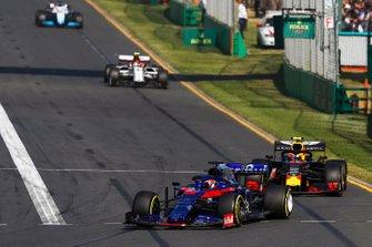 Daniil Kvyat, Toro Rosso STR14, leads Pierre Gasly, Red Bull Racing RB15, and Antonio Giovinazzi, Alfa Romeo Racing C38