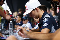 Pierre Gasly, Reserve Driver, Red Bull Racing, signs autographs for fans