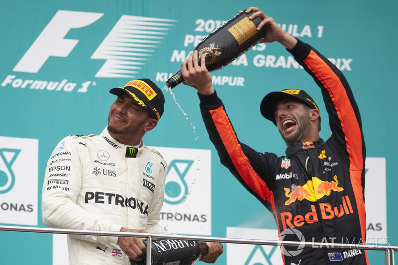 third place Daniel Ricciardo, Red Bull Racing, pours Champagne over second place Lewis Hamilton, Mercedes AMG F1