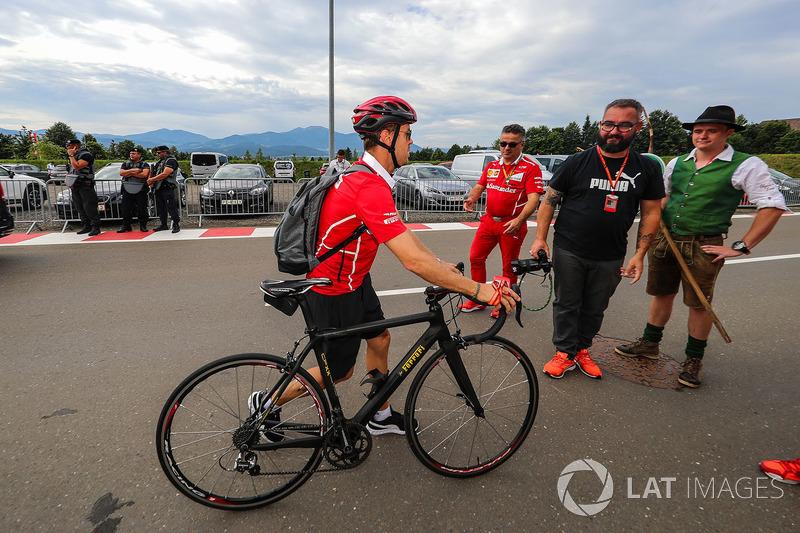 Sebastian Vettel, Ferrari arrives on his bike