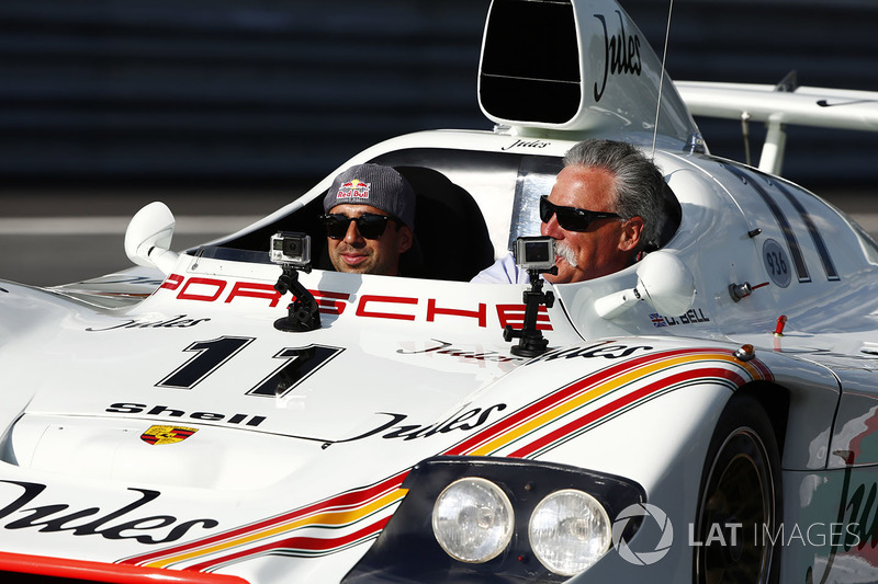 Chase Carey, Chairman, Formula One, rides in a Porsche 936 racer driven by Neel Jani