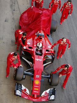 Sebastian Vettel, Ferrari, returns to the pits with a car problem