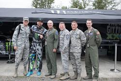 Vaughn Gittin Jr. with members of the military