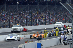 Fernando Alonso, Andretti Autosport Honda and the rest of the field wait during a red flag period