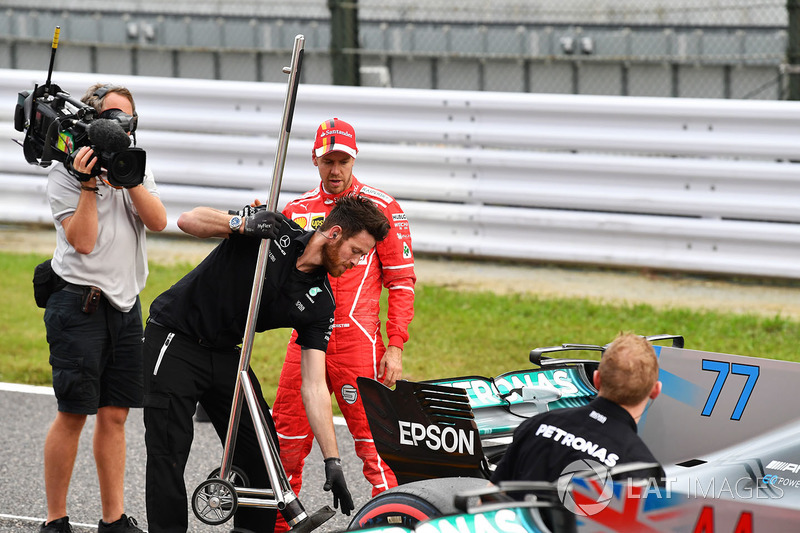 Sebastian Vettel, Ferrari and Mercedes AMG F1 mechanic in parc ferme