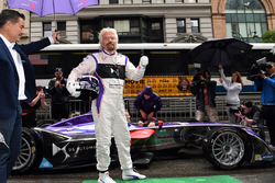 Richard Branson poses for a photo with a DS Virgin Racing Spark