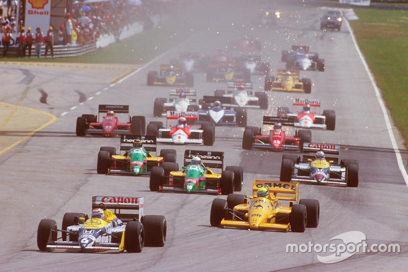 Nelson Piquet, Williams FW11B Honda, leads Ayrton Senna, Team Lotus Honda 99T, Teo Fabi, Benetton B187 Ford, Thierry Boutsen, Benetton B187 Ford and Nigel Mansell, Williams FW11B Honda, at the start