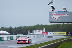 Kevin Lacroix, takes the checkered flag