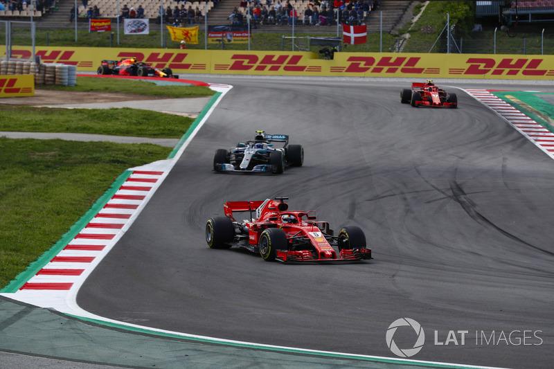 Себастьян Феттель, Ferrari SF71H, Валттери Боттас, Mercedes AMG F1 W09, и Кими Райкконен, Ferrari SF71H
