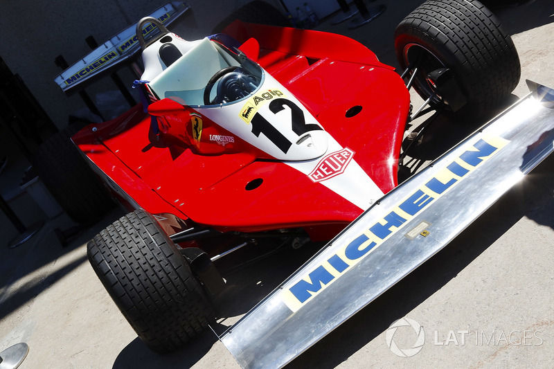 A 1978 Ferrari 312 in the paddock