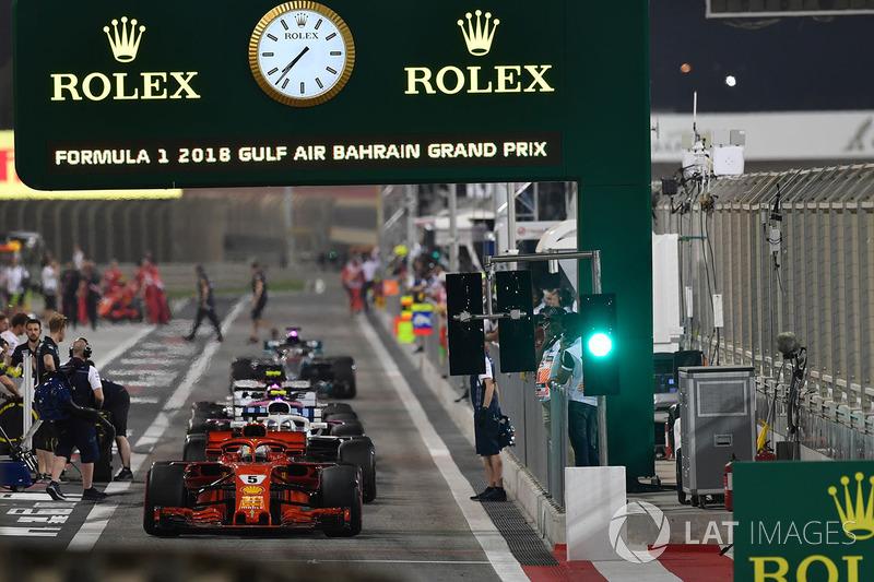 Sebastian Vettel, Ferrari SF71H and cars at the end of pit lane