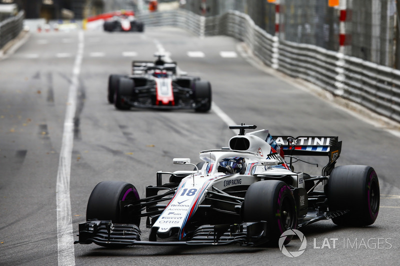 Lance Stroll, Williams FW41, leads Romain Grosjean, Haas F1 Team VF-18