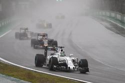 Felipe Massa, Williams FW38 Mercedes, leads Daniil Kvyat, Toro Rosso STR11, and Carlos Sainz Jr, Toro Rosso STR11