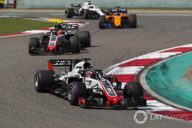Romain Grosjean, Haas F1 Team VF-18 Ferrari, Kevin Magnussen, Haas F1 Team VF-18 Ferrari, and Fernan