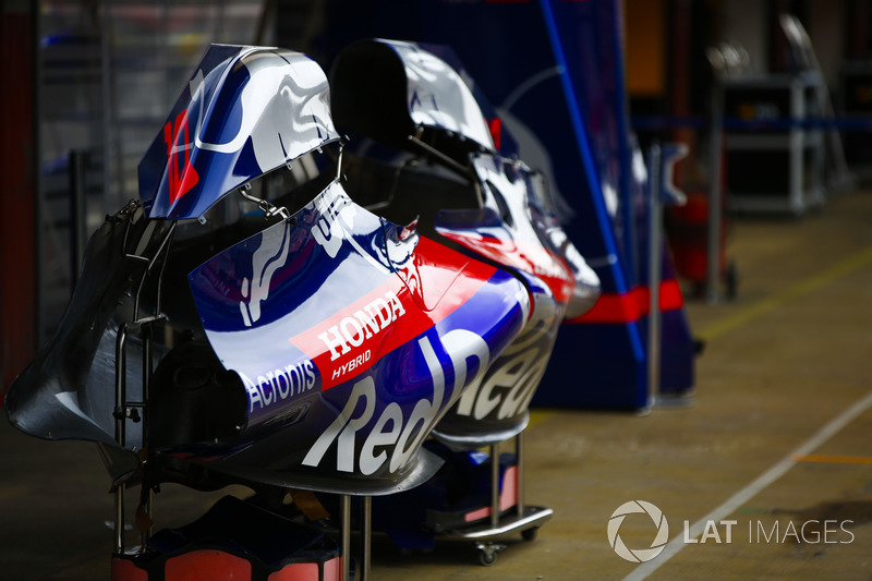 Bodywork belonging to the Toro Rosso STR13 cars in the pit lane