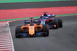 Fernando Alonso, McLaren MCL33 leads Pierre Gasly, Scuderia Toro Rosso STR13