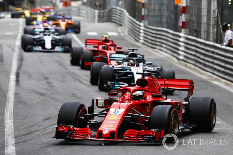 Sebastian Vettel, Ferrari SF71H, leads Lewis Hamilton, Mercedes AMG F1 W09, Kimi Raikkonen, Ferrari SF71H, Valtteri Bottas, Mercedes AMG F1 W09