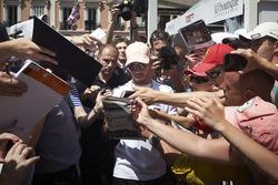 Lewis Hamilton, Mercedes AMG F1, signs autographs