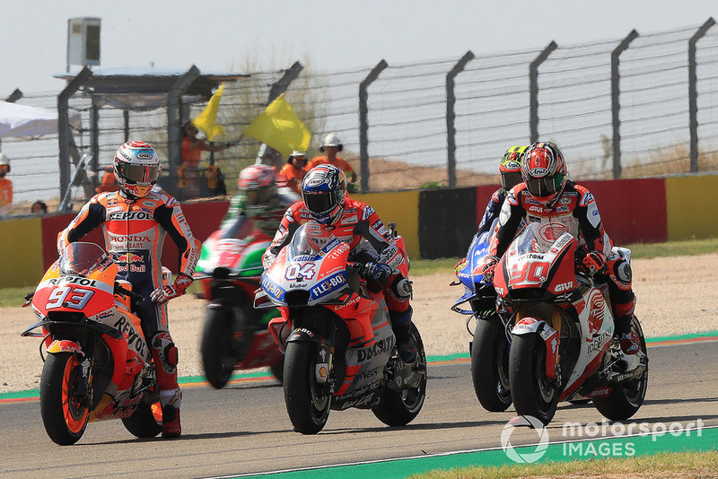 Marc Márquez, Repsol Honda Team, Andrea Dovizioso, Ducati Team, practican una arrancada