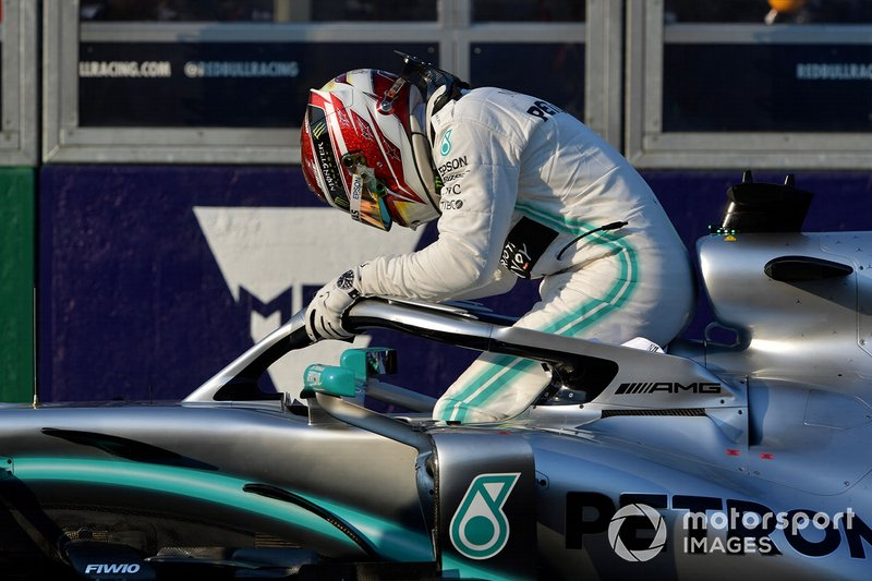 Lewis Hamilton, Mercedes AMG F1, climbs out of his car after securing pole position