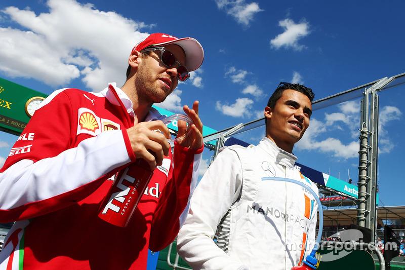 Sebastian Vettel, Ferrari and Pascal Wehrlein, Manor Racing