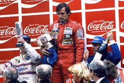 Podium: race winner Carlos Reutemann, Williams, second place Jacques Laffite, Talbot Ligier Matra, third place Nigel Mansell, Team Lotus