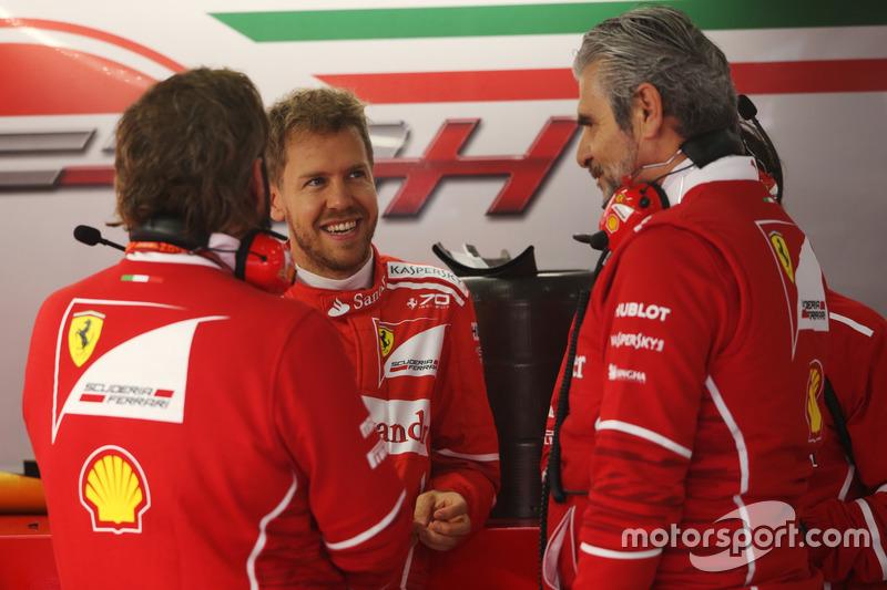 Sebastian Vettel, Ferrari, talks to Maurizio Arrivabene, Team Principal, Ferrari and a team mate