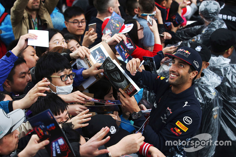 Daniel Ricciardo, Red Bull Racing, signs autographs for fans