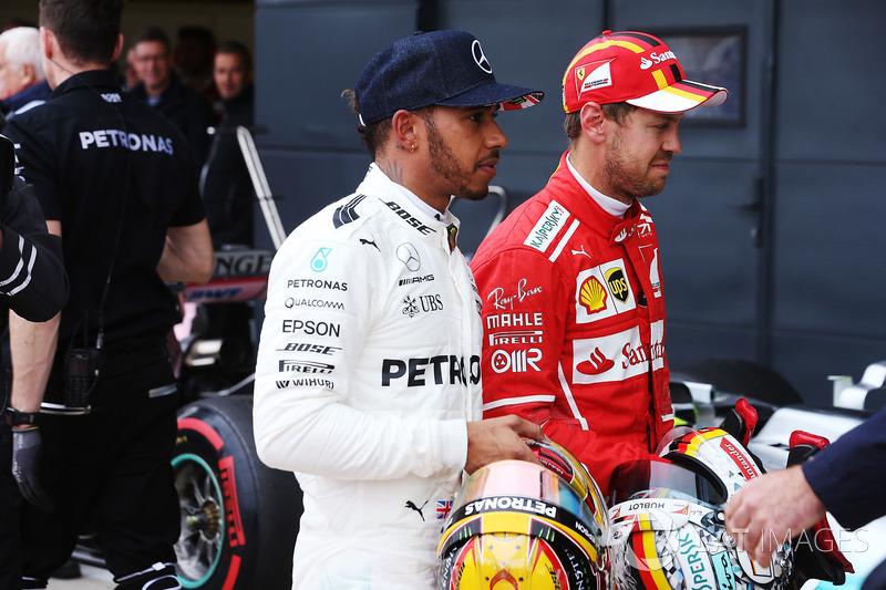Polesitter Lewis Hamilton, Mercedes AMG F1, title rival Sebastian Vettel, Ferrari