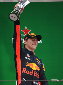 Max Verstappen, Red Bull Racing,celebrates with his trophy on the podium