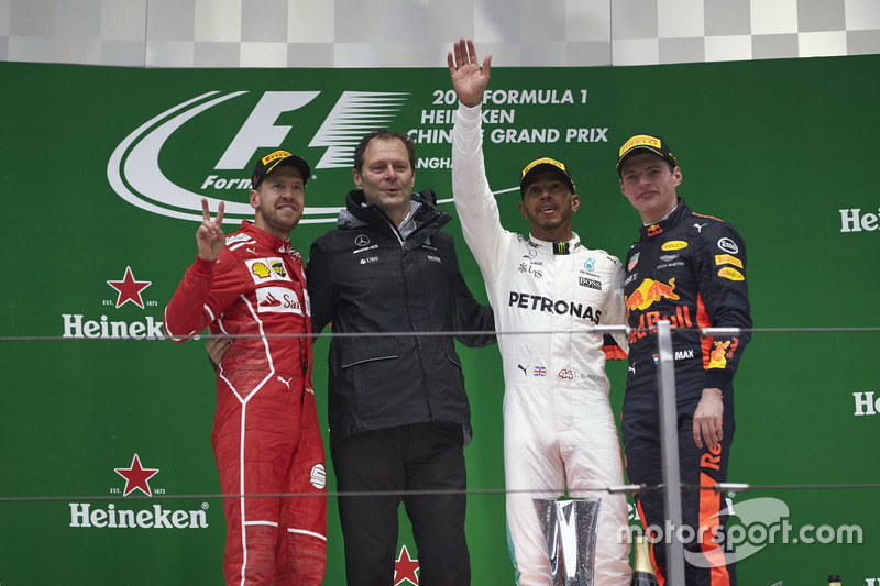 Podium: second place Sebastian Vettel, Ferrari, Aldo Costa, Engineering Director, Mercedes AMG, Race