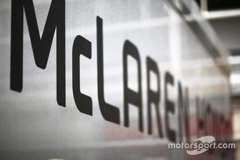 Rain falls on the McLaren Honda trucks in the paddock