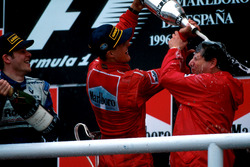 Winner Michael Schumacher, Ferrari F310 covers Jean Todt with Jacques Villeneuve, Williams