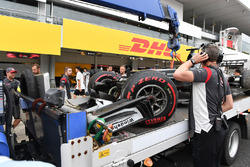 The crashed car of Romain Grosjean, Haas F1 Team VF-17 is recovered in Q1