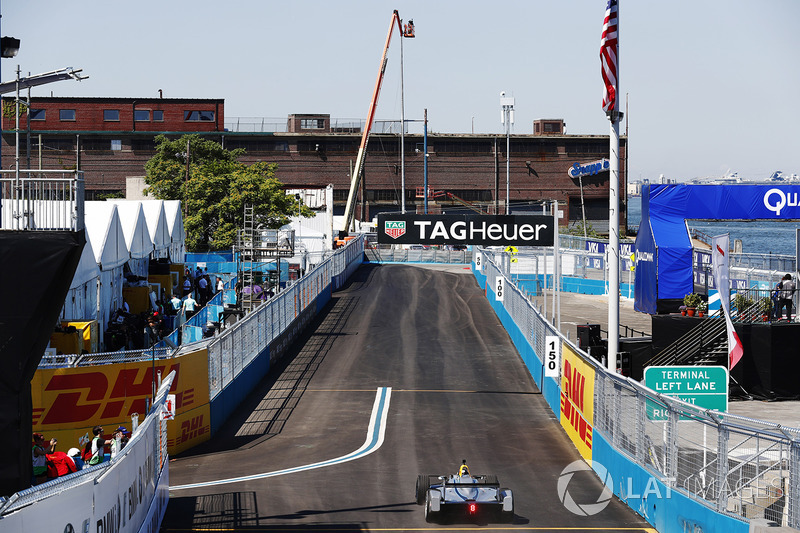 Chris Hemsworth drives the Formula E car