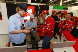 Owen Wilson and Woody Harrelson receive a tour of the Ferrari garage from Sergio Marchionne, Chief E