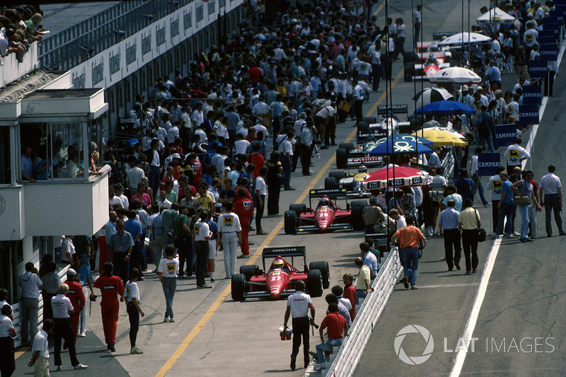 The Ferraris of Alboreto and Stefan Johansson head down pitlane at Hockenheim in '86. As usual that year, they had a dreadful race.
