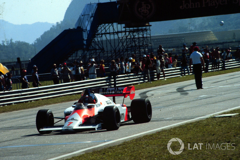 Alain Prost, McLaren MP4/2, takes the checkered flag