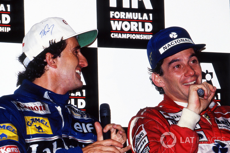 World Champion Alain Prost, Williams, and race winner Ayrton Senna, McLaren, during the post race press conference