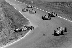 Giancarlo Baghetti leads in the Ferrari 156, while Lotus 21 driver Innes Ireland gets it crossed up