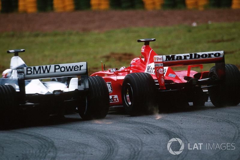 Juan Pablo Montoya, BMW Williams FW23; Michael Schumacher, Ferrari F1 2001