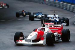 David Coulthard, McLaren MP4/11B, wearing Michael Schumacher's spare helmet