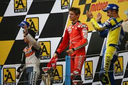 Podium: second place Dani Pedrosa; Winner Casey Stoner, Ducati; third place Colin Edwards, Yamaha
