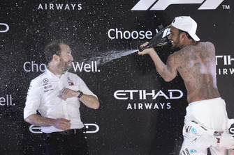 Lewis Hamilton, Mercedes AMG F1, 1st position, sprays Bradley Lord, Communications Director, Mercedes AMG, on the podium