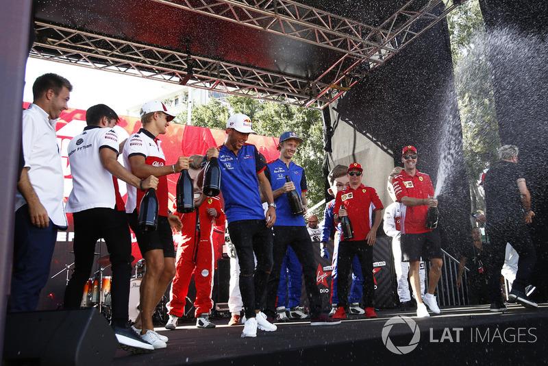 Charles Leclerc, Alfa Romeo Sauber F1 Team, Marcus Ericsson, Alfa Romeo Sauber F1 Team, Pierre Gasly, Scuderia Toro Rosso Toro Rosso, Brendon Hartley, Scuderia Toro Rosso and Sebastian Vettel, Ferrari spray the champagne on stage