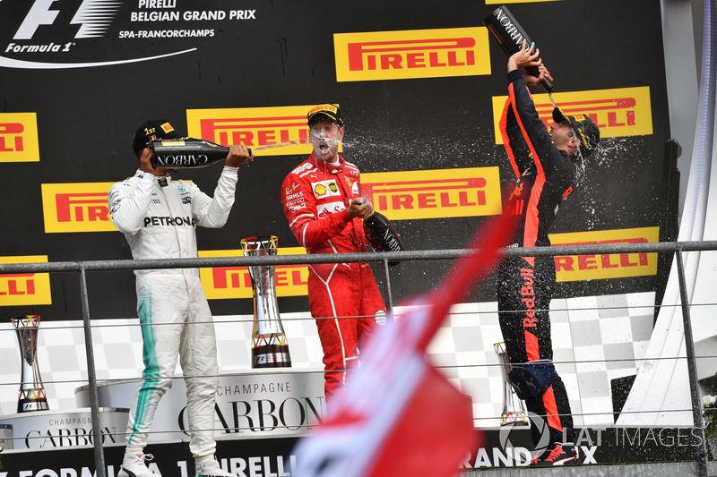 Lewis Hamilton, Mercedes AMG F1, Sebastian Vettel, Ferrari and Daniel Ricciardo, Red Bull Racing celebrate on the podium, the champagne