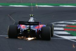 Sparks fly from Carlos Sainz Jr., Scuderia Toro Rosso STR12