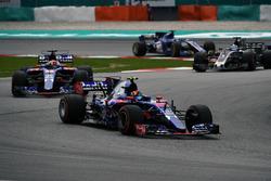 Carlos Sainz Jr., Scuderia Toro Rosso STR12 leads Pierre Gasly, Scuderia Toro Rosso STR12