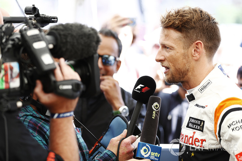 Jenson Button, McLaren, is interviewed